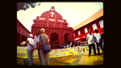 Time lapse of  Christ Church  with tourists and Rickshaws.  Melaka, Malaysia. Stock Footage