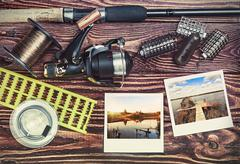Fishing tackle and photoframe Stock Photos