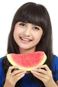 woman ready to take a bite out of watermelon - stock photo