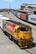 Freight trains in railyard - stock photo