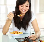 Text message and eating Stock Photos