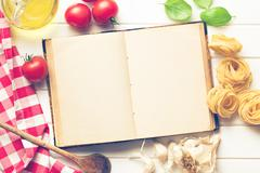 blank recipe book and fresh ingredients - stock photo