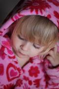 portrait of little girl with pink hood - stock photo