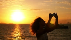 Woman Making Photo of Sunset. Deck of Cruise Ship. Slow Motion Stock Footage