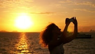 Stock Video Footage of Woman Making Photo of Sunset. Deck of Cruise Ship. Slow Motion