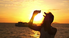 Beautiful Woman Taking Selfie against Sunset during Sea Cruise. Slow Motion. Stock Footage