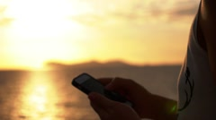 Stock Video Footage of Woman Hands Using iPhone at Sunset in Slow Motion