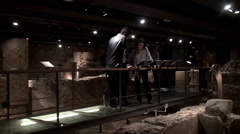 Tourists in the archaeological underground of Barcelona City History Museum. Stock Footage