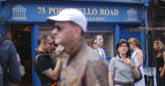 Tourists pass Portobello RD Antiques shop 4K Stock Footage