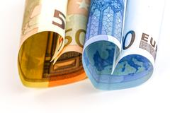 two euro bill in the form of a heart - stock photo