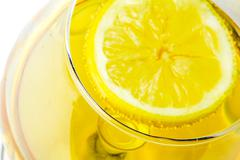 limon on alcohol glass - stock photo