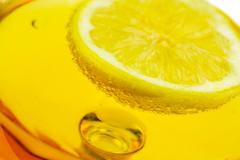 Limon on alcohol glass Stock Photos