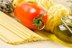 spaghetti and tomatoes with herbs - stock photo