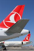 Tails of turkish airlines airplanes at istanbul airport Stock Photos