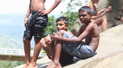 Young boys shivering after swimming in the Ravana Falls in Ella, Sri Lanka. Stock Footage