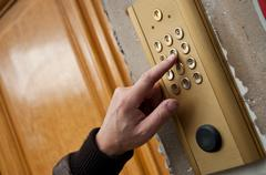 hand of man in the door with digicode - stock photo