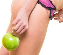 Young girl with nice body and apple in hand Stock Photos