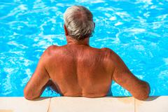 Active seniors getting a workout at the swimming pool Stock Photos