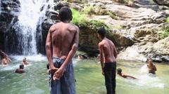 ELLA, SRI LANKA - MARCH 2014: Boys enjoying and bathing in Ravana Falls. Stock Footage