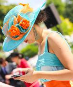 elegant woman with her beautiful hat - stock photo