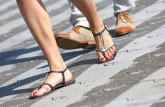 Opposition about flip-flops and dress shoes Stock Photos