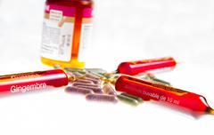 close up of vitamin ampuls and natural pills - stock photo