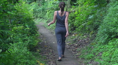 Young woman walking in indonesia tropical forest super slow motion,240Fps HD Stock Footage