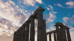 Golden sunset Ancient Temple of Poseidon Sounio Greece 25p zoom out Stock Footage