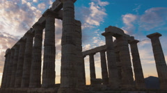 Golden sunset Ancient Temple of Poseidon Sounio Greece dolly right to left 25p Stock Footage