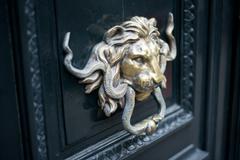 sculpture of lion on door - stock photo