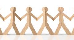 row of cutout paper cardboard men - stock illustration