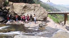 ELLA, SRI LANKA - MARCH 2014: The Locals enjoying the Ravana Falls. Stock Footage