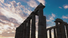 Golden sunset Ancient Temple of Poseidon Sounio Greece zoom out 30p - stock footage