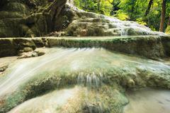 Lime stone water fall in arawan water fall national park kanchanaburi thailan Stock Photos