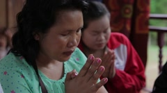 Lao Woman in Prayer Stock Footage