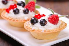 berry tartlets  (  raspberry, redcurrant and blackberry ) - stock photo