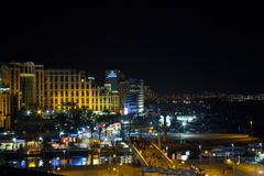view on the aqaba gulf and eilat city at the evening , israel - stock photo