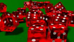 Dice rolling clear red slow motion closeup DOF on green felt tabletop - stock footage