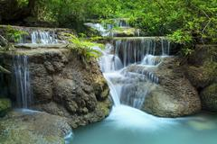 lime stone water fall in arawan water fall national park kanchanaburi thailan - stock photo