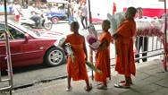 Stock Video Footage of Three Buddhist novices carrying flowers in Bankok