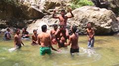 ELLA, SRI LANKA - MARCH 2014: People enjoying the Ravana Falls in Ella. Stock Footage