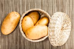 potato in wattled  box - stock photo