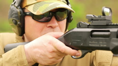 A man fires a rifle Stock Footage
