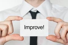 improve. businessman holding business card - stock photo