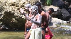 ELLA, SRI LANKA - MARCH 2014: Men washing with soap in Ravana Falls. Stock Footage