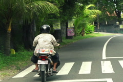 People riding motorbike in Bali, Indonesia, super slow motion, 240fps NTSC Stock Footage