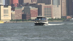 Blue and yellow water taxis New York City Stock Footage