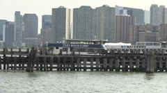East River water taxi arrives Hoboken New Jersey Stock Footage