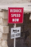 reduce speed now - stock photo