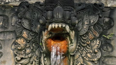 Water flowing from dragon sculpture, hot springs Bali, super slow motion HD Stock Footage